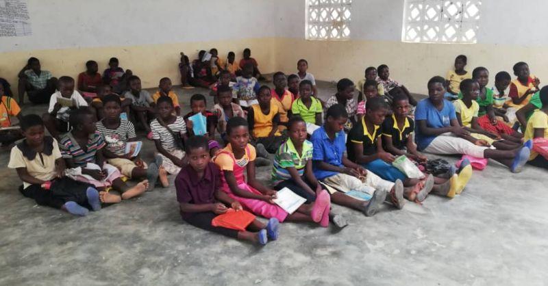 Older children sitting on the classroom floor