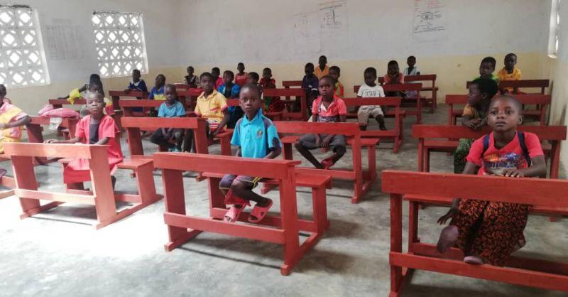Children sitting on the desks