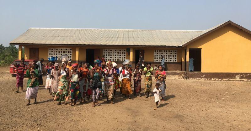 Women singing in front of school