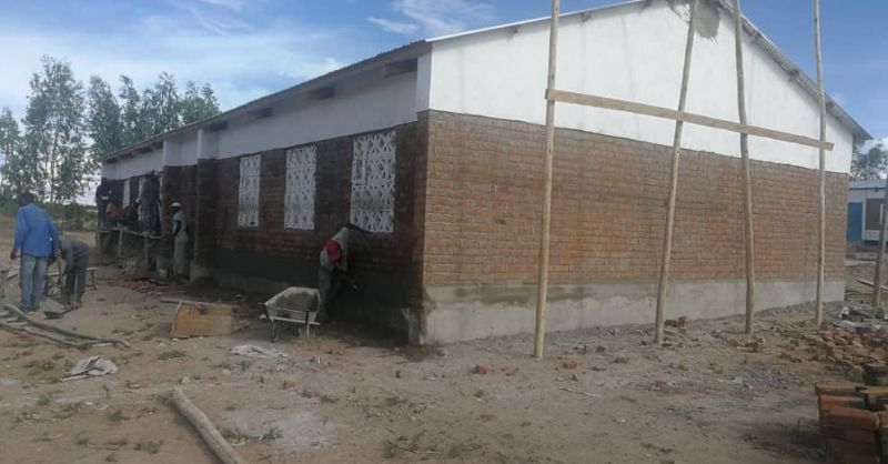 Plastering work on lower part of classroom block
