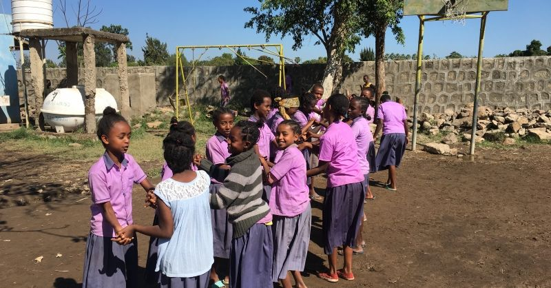 School children playing on the compound