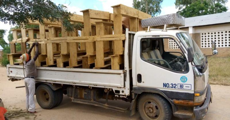 Truck carrying desks
