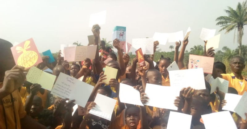 Cards in hands of the children in Barmoi Luma