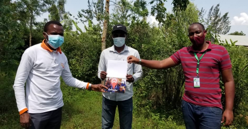 Coordinator Pascal (left) bringing cards to community