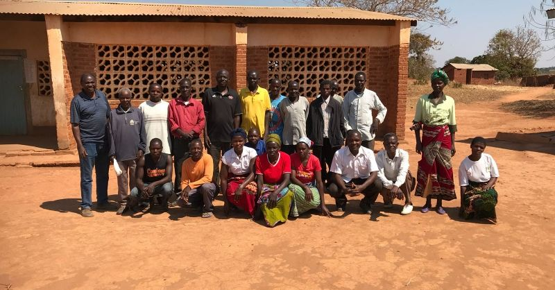 The people from the community in front of the school