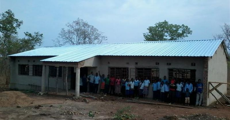 Community in front of school
