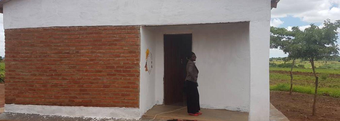De lerares is erg blij met haar nieuwe woning
